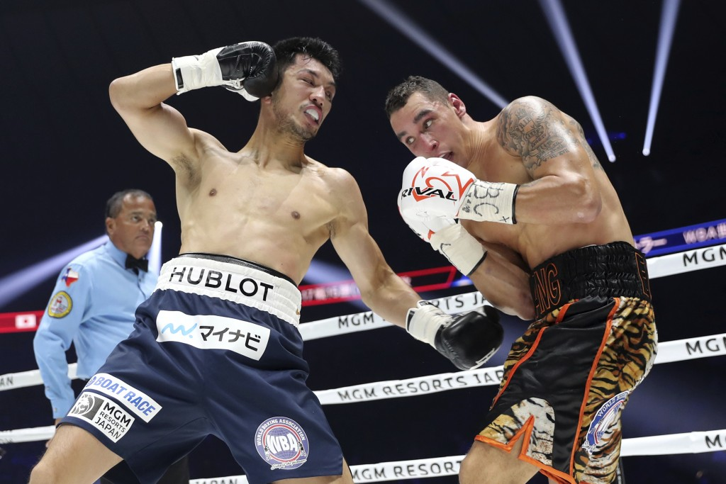In this Monday, Dec. 23, 2019, file photo, Japanese champion Ryota Murata, left, sends a left hook to Canadian challenger Steve Butler in the second r...
