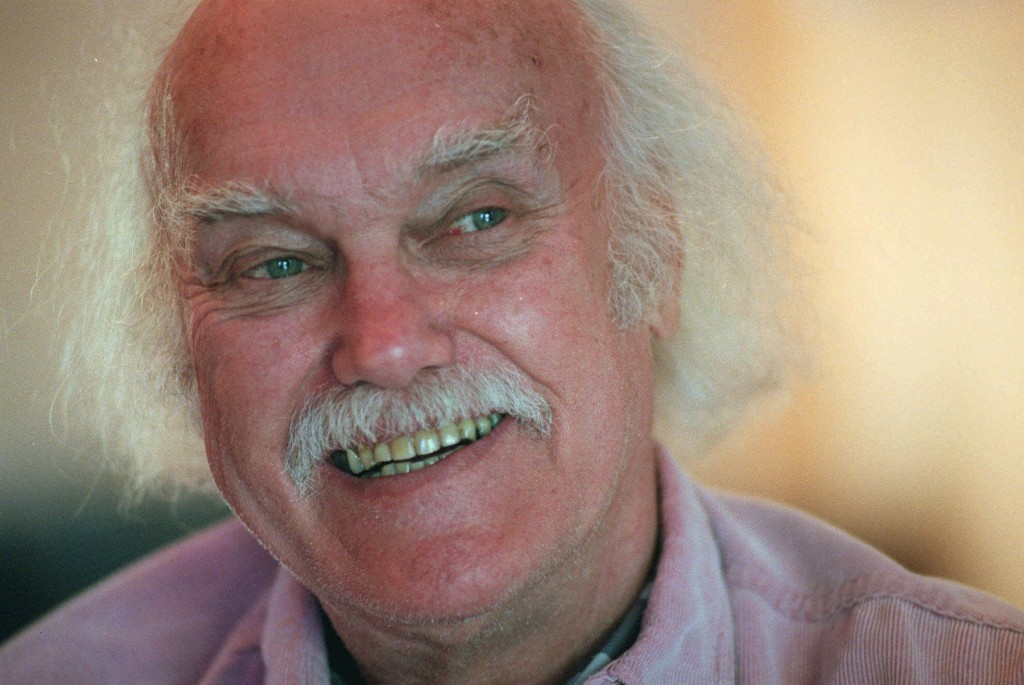 """FILE - In this Oct. 21, 1998 file photo, Ram Dass, best known for the 1971 bestseller """"Be Here Now,"""" smiles during an interview at his San Anselmo, Ca..."""