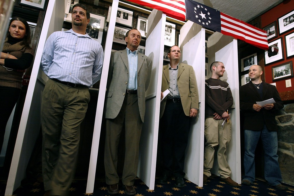 FILE - In this Nov. 4, 2008, file photo Dixville Notch residents wait for the stroke of midnight to be the first voters for the nation's presidential ...