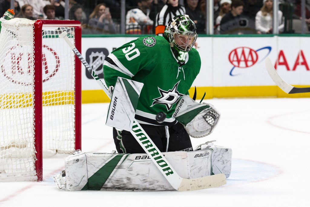 Dallas Stars goaltender Ben Bishop (30) stops a shot attempt during the second period of an NHL hockey game against the Calgary Flames, Sunday, Dec. 2...