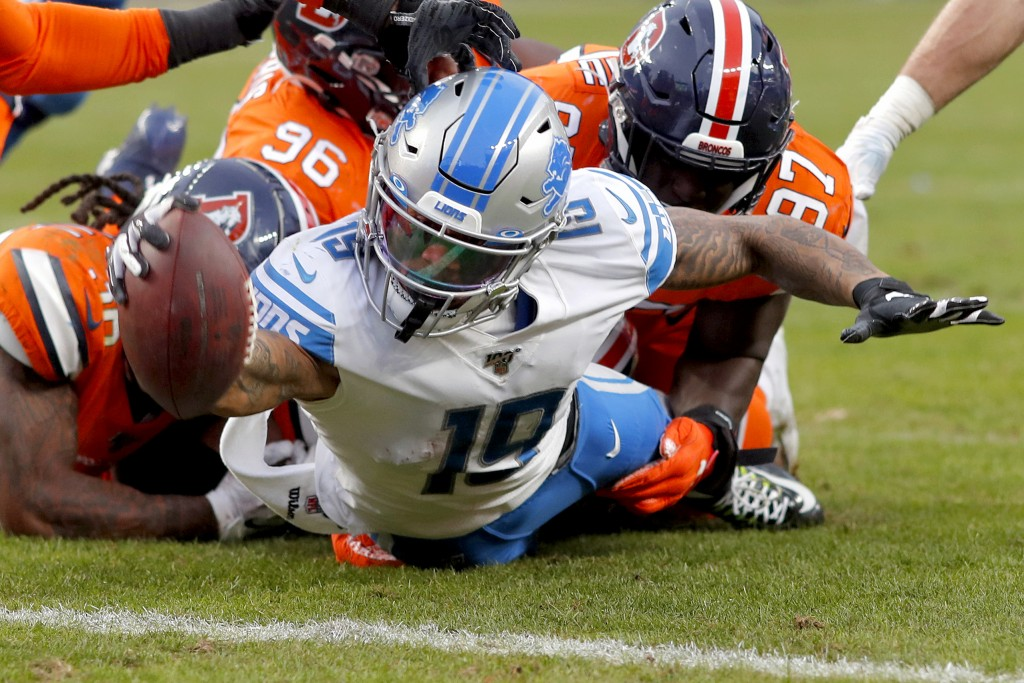 Detroit Lions wide receiver Kenny Golladay (19) dives in for a touchdown against the Denver Broncos during the second half of an NFL football game, Su...
