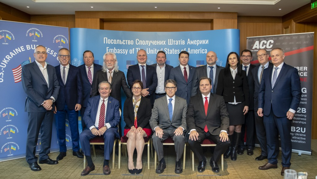FILE - In this Nov. 12, 2018, photo provided by the U.S. Embassy in Kyiv, Ukraine, Energy Secretary Rick Perry, front center, poses for a photo after ...