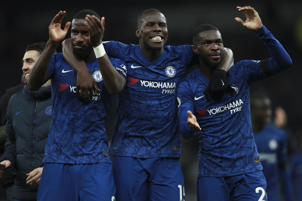 From left, Chelsea's Antonio Rudiger, Kurt Zouma and Fikayo Tomori celebrate their side's 2-0 win at the end of the English Premier League soccer matc...