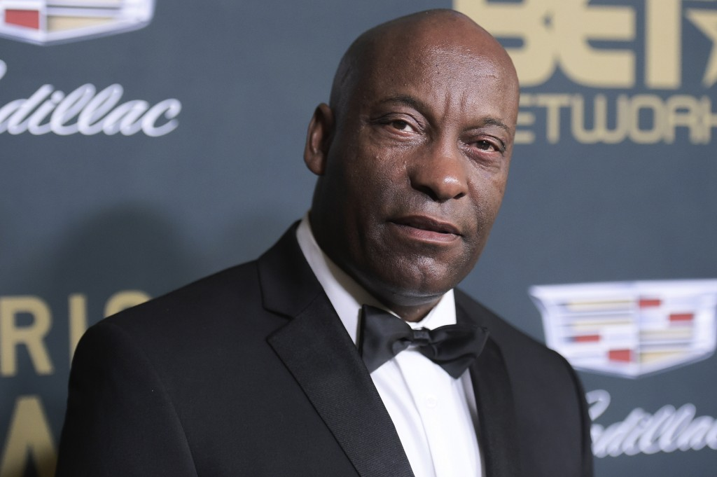FILE - In this Sunday, Feb. 25, 2018 file photo, John Singleton attends the 2018 American Black Film Festival Honors at the Beverly Hilton Hotel in Be...