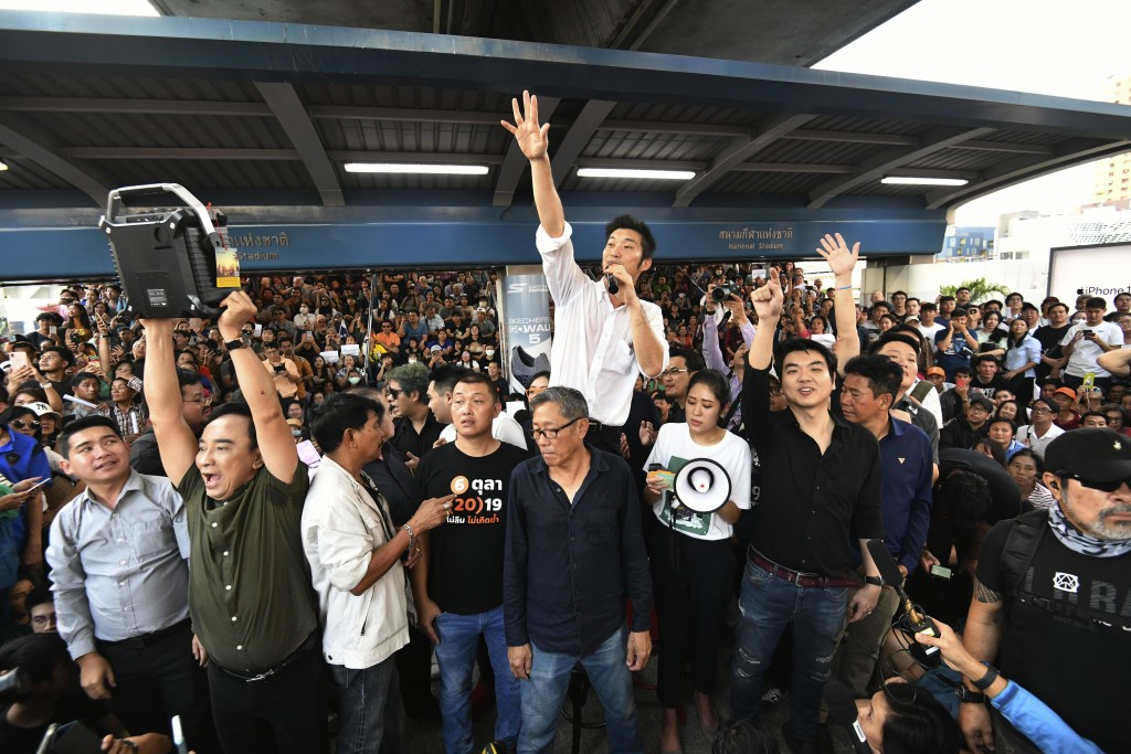 FILE - In this Dec. 14, 2019, file photo, Thailand's Future Forward Party leader Thanathorn Juangroongruangkit talks to his supporters during rally in...