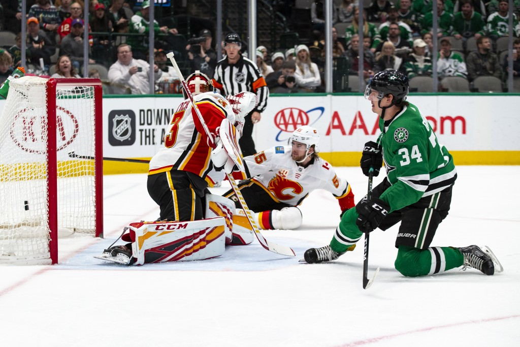 Dallas Stars right wing Denis Gurianov (34) watches as his shot goes into the goal past Calgary Flames goaltender David Rittich (33) during the first ...