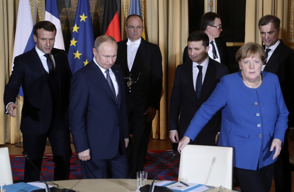 FILE - In this Monday, Dec. 9, 2019 file photo, French President Emmanuel Macron, left, Russian President Vladimir Putin, second left, German Chancell...
