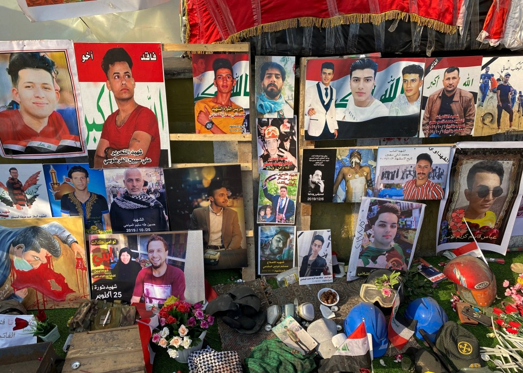 Posters of protesters who have been killed in demonstrations and their belongings are displayed in Tahrir Square during anti-government protests in Ba...