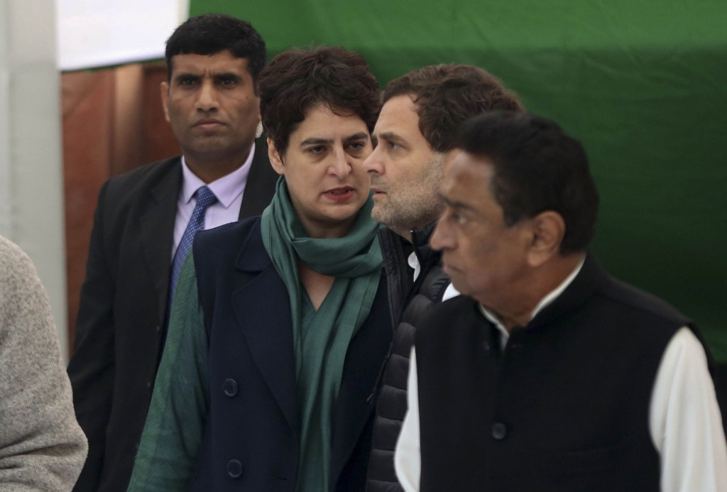 India's main opposition Congress party leader Rahul Gandhi, second right, listens to his sister Priyanka Vadra during a silent protest against a conte...