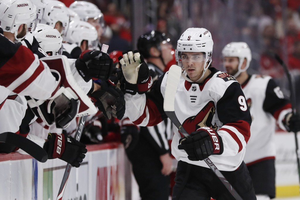 Arizona Coyotes right wing Clayton Keller high-fives teammates after scoring during the first period of an NHL hockey game against the Detroit Red Win...