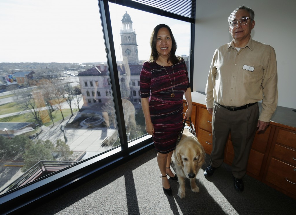 In this Friday, Dec. 13, 2019, photograph, Colorado Springs, Colo., council members Yolanda Avila and Andres Pico are shown in a city office in Colora...