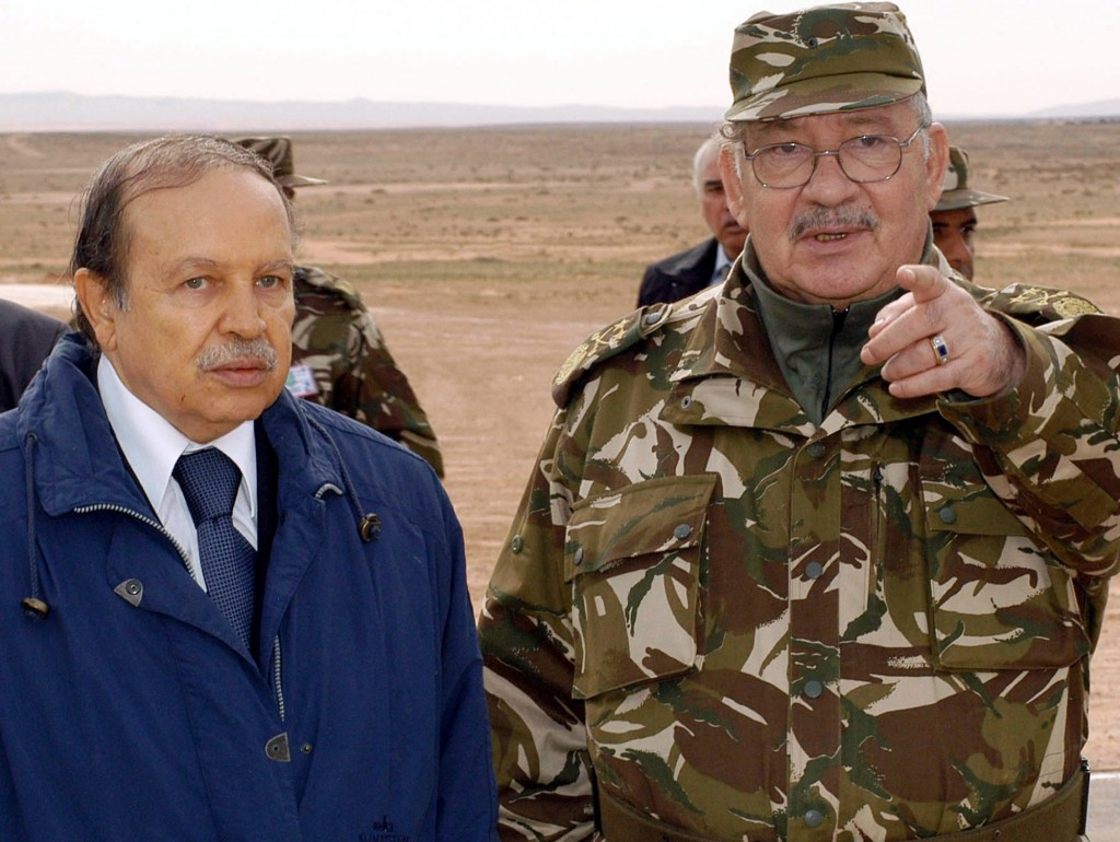 FILE - In this Nov. 21, 2005 file photo, Algerian National Army Chief of Staff, General Ahmed Gaid Salah, right, gestures as he speaks with Algerian P...