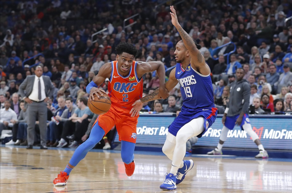 Oklahoma City Thunder guard Shai Gilgeous-Alexander (2) drives to the basket around Los Angeles Clippers guard Rodney McGruder (19) during the second ...