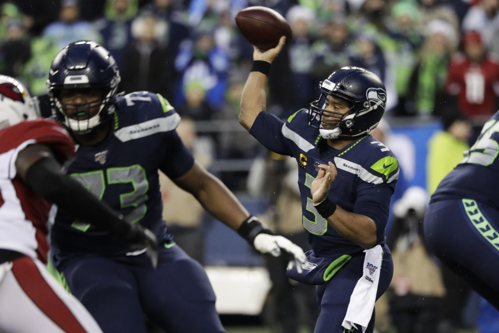 Seattle Seahawks quarterback Russell Wilson (3) passes against the Arizona Cardinals during the second half of an NFL football game, Sunday, Dec. 22, ...