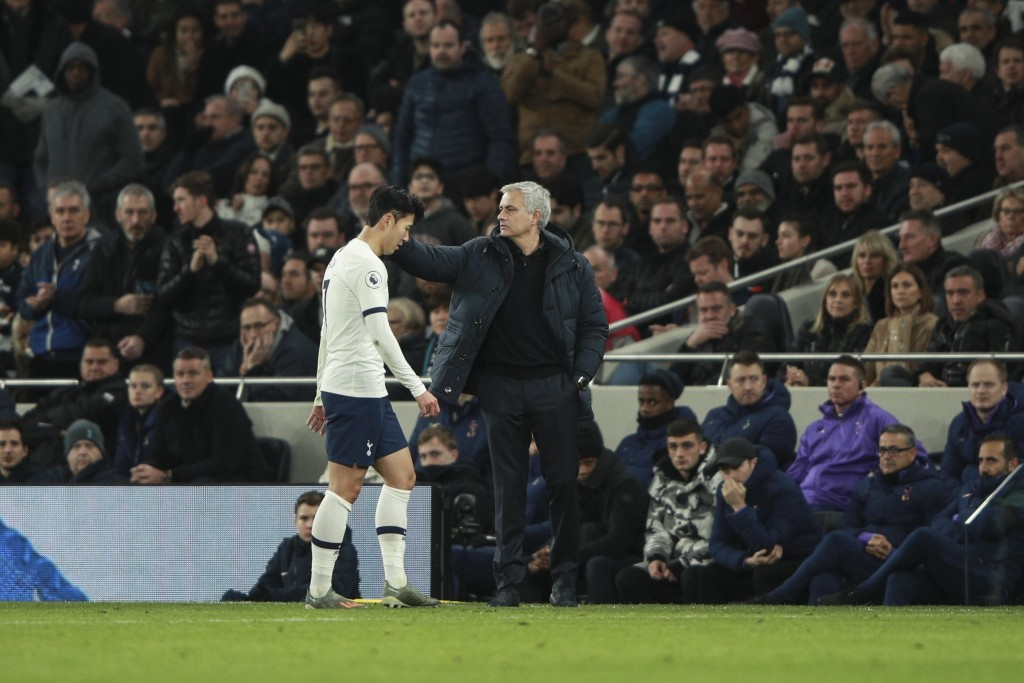 Tottenham's Son Heung-min is consoled by Tottenham's manager Jose Mourinho as he leaves the pitch after getting a red card, during the English Premier...