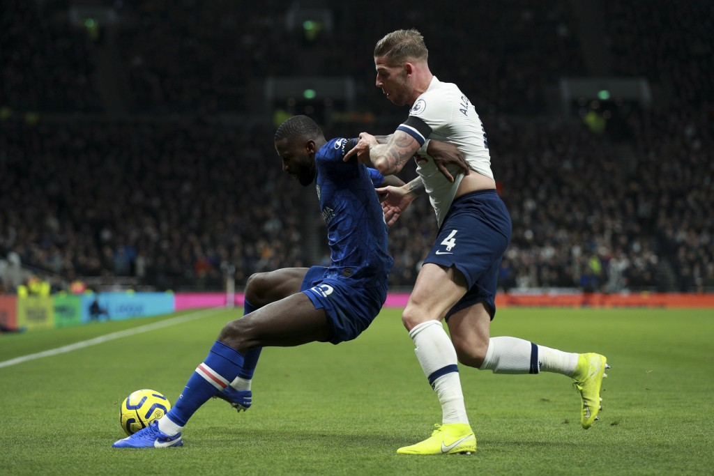 Chelsea's Antonio Rudiger, left, is tackled by Tottenham's Toby Alderweireld during the English Premier League soccer match between Tottenham Hotspur ...