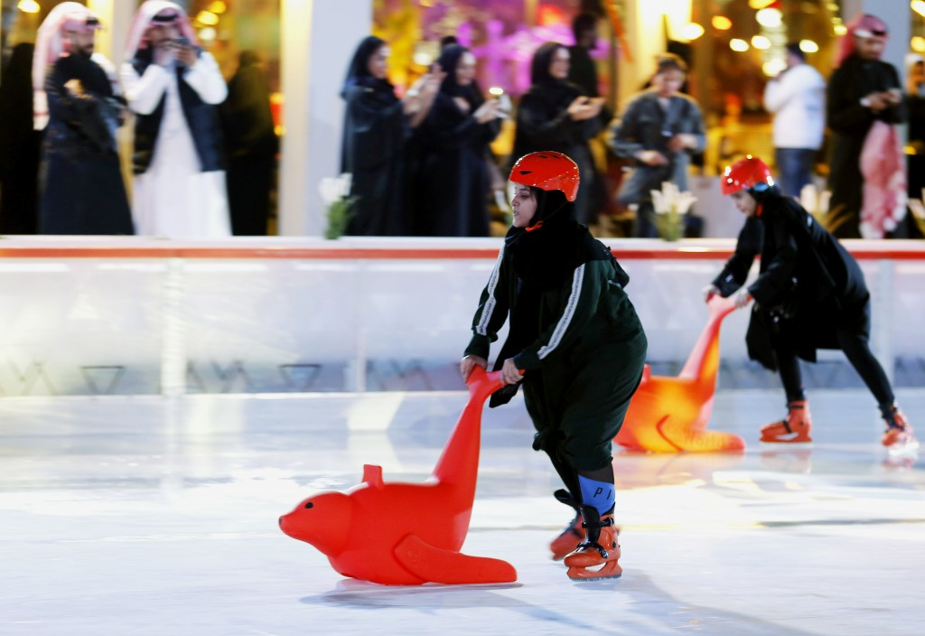 In this Dec. 13, 2019 photo, visitors play ice skating at the Diriyah Oasis amusement park in Diriyah on the outskirts of Riyadh, Saudi Arabia. Hollyw...
