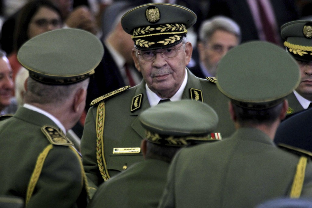 FILE - In this photo taken Thursday, Dec. 19, 2019, Algerian military chief Gaid Salah attends president Abdelmajid Tebboune's inauguration ceremony i...
