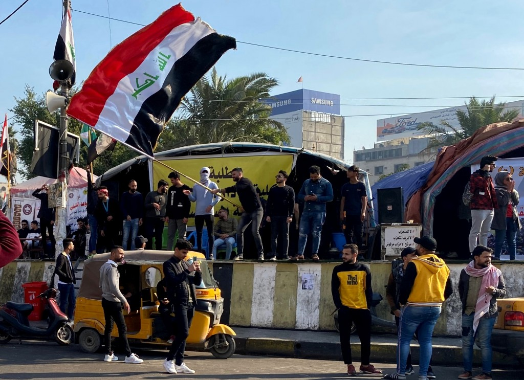 Anti-government protesters gather in Tahrir Square in Baghdad, Iraq, Sunday, Dec. 22, 2019. Thousands of protesters poured into the streets of Baghdad...