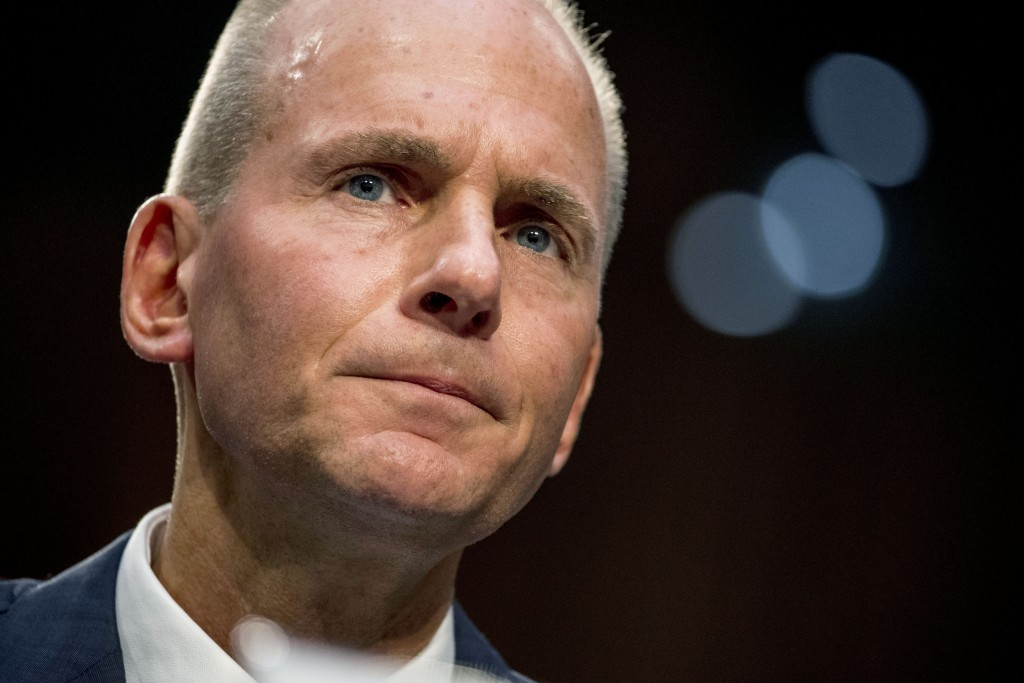FILE - In this Oct. 29, 2019, file photo Boeing Company President and Chief Executive Officer Dennis Muilenburg appears before a Senate Committee on C...