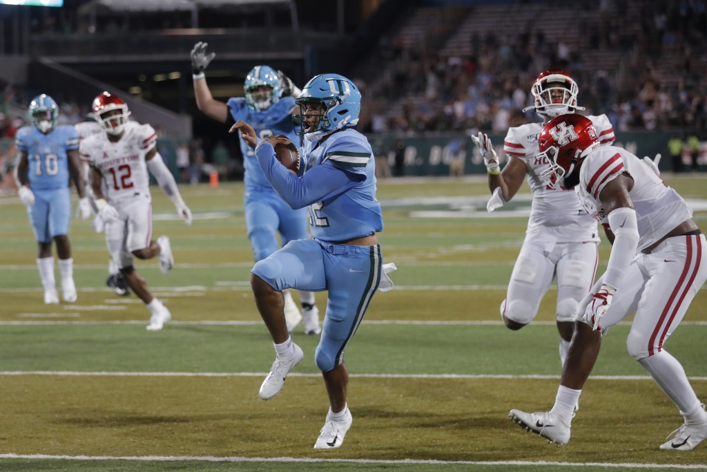 FILE - In this Sept. 19, 2019, file photo, Tulane quarterback Justin McMillan (12) runs the ball in for a touchdown during the second half of an NCAA ...