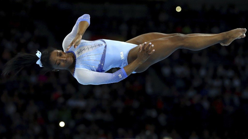 FILE- In this Oct. 5, 2019, file photo, Simone Biles, of the United States, performs on the floor during qualifying sessions for the Gymnastics World ...