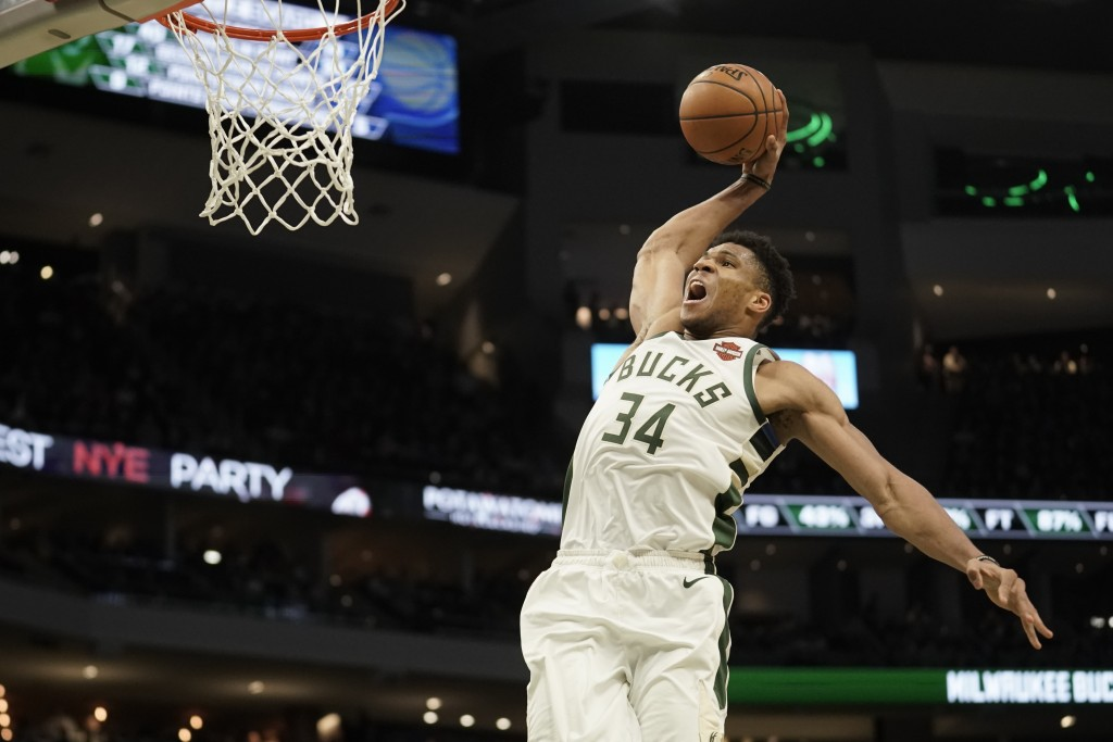 Milwaukee Bucks' Giannis Antetokounmpo dunks during the second half of an NBA basketball game against the Indiana Pacers Sunday, Dec. 22, 2019, in Mil...