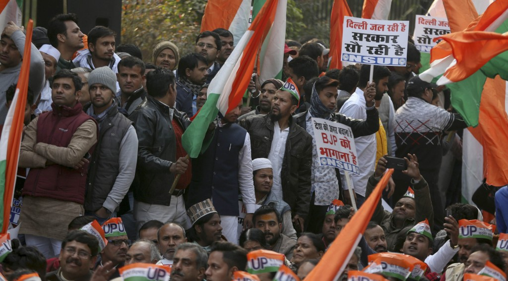 India's main opposition Congress party supporters wave Indian flag during a silent protest against a contentious new citizenship law, in New Delhi, In...