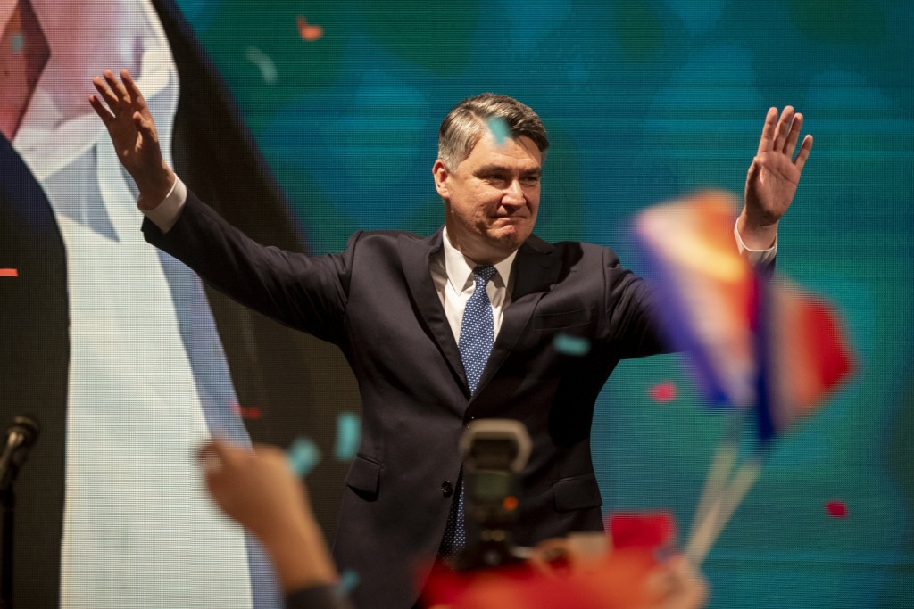 Presidential candidate Zoran Milanovic greets his supporters in Zagreb, Croatia, Sunday, Dec. 22, 2019. The race for Croatia's next president is headi...