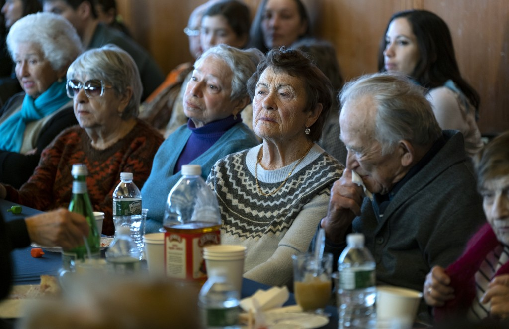 Survivors of the Holocaust and others listen to remarks as they gather at the Museum of Jewish Heritage in New York Sunday, Dec. 22, 2019, to recogniz...