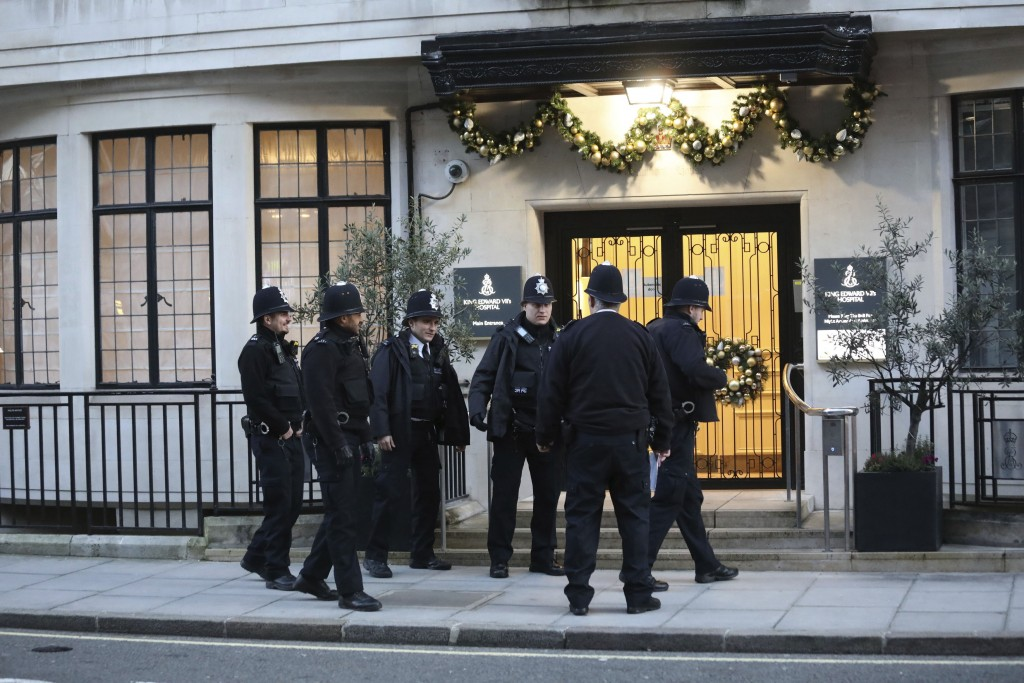 Police officers outside the main entrance of King Edward VII Hospital, where Prince Philip is being treated Monday Dec. 23, 2019.  Prince Philip has s...