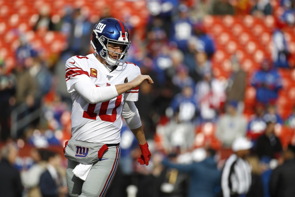New York Giants quarterback Eli Manning works out prior to an NFL football game against the Washington Redskins, Sunday, Dec. 22, 2019, in Landover, M...