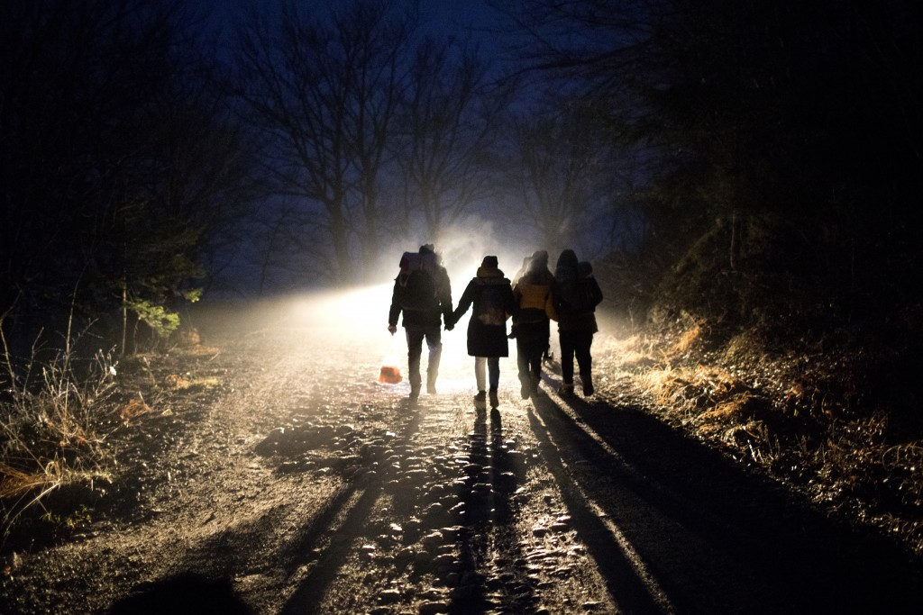 In this picture taken Thursday Dec. 12, 2019, Indian migrants Nishademi, 22, and Suhil, 23, walk with Saif, 33, Fatma, 24, and their son Omar, 1, Syri...