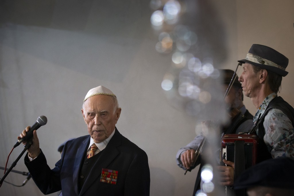 Holocaust survivor and WWII veteran Mikhail Spectr, 86, pauses as he speaks during the annual Hanukkah Menorah Lighting Ceremony in Moscow, Russia, Su...