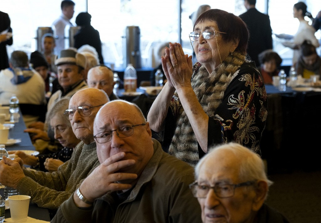 Survivors of the Holocaust and others listen to music as they gather at the Museum of Jewish Heritage in New York Sunday, Dec. 22, 2019, to recognize ...
