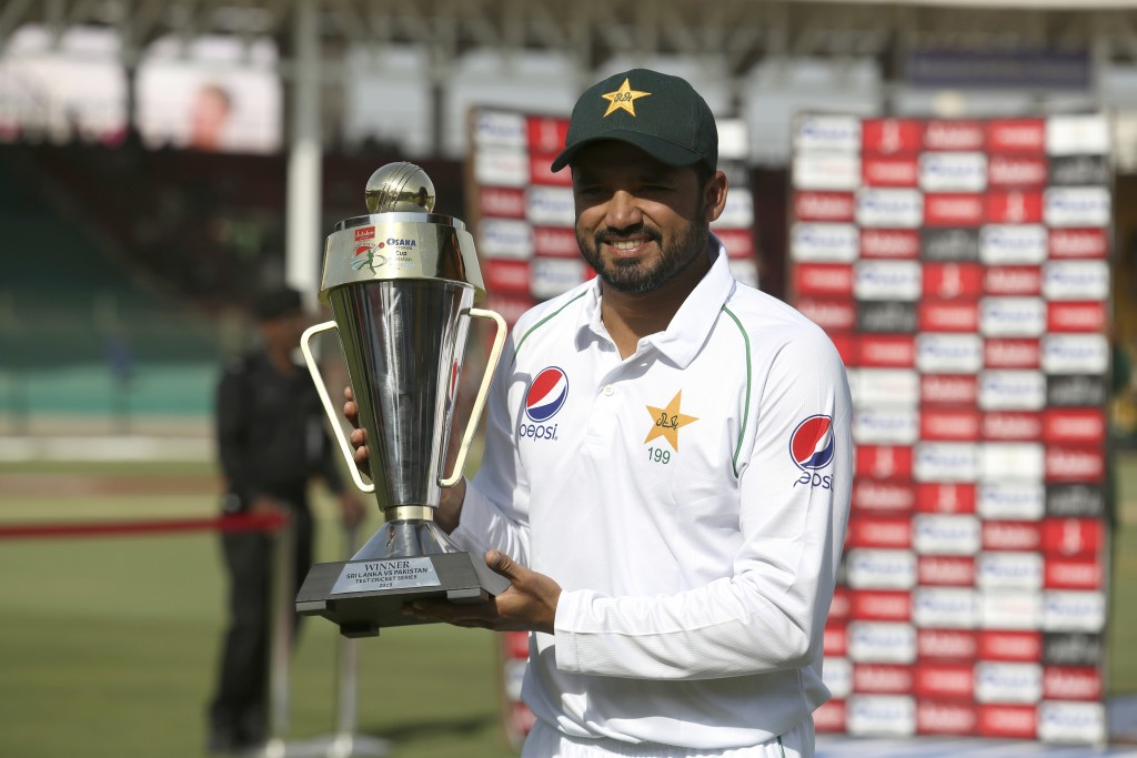 Pakistani captain Azhar Ali holds a trophy to celebrate the victory against Sri Lanka in the second test in Karachi, Pakistan, Monday, Dec. 23, 2019. ...
