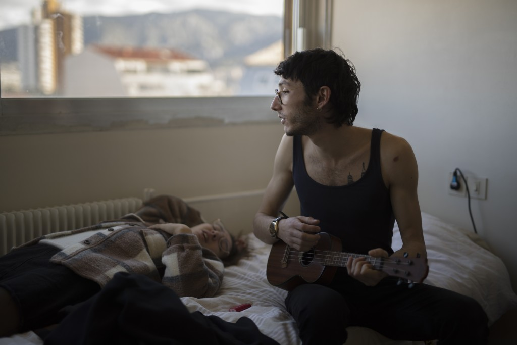 In this photo taken on Dec.15, 2019 Vincent Achour, a hospital intern in psychiatry and his sister Pauline sing together to a ukelele in the intern re...
