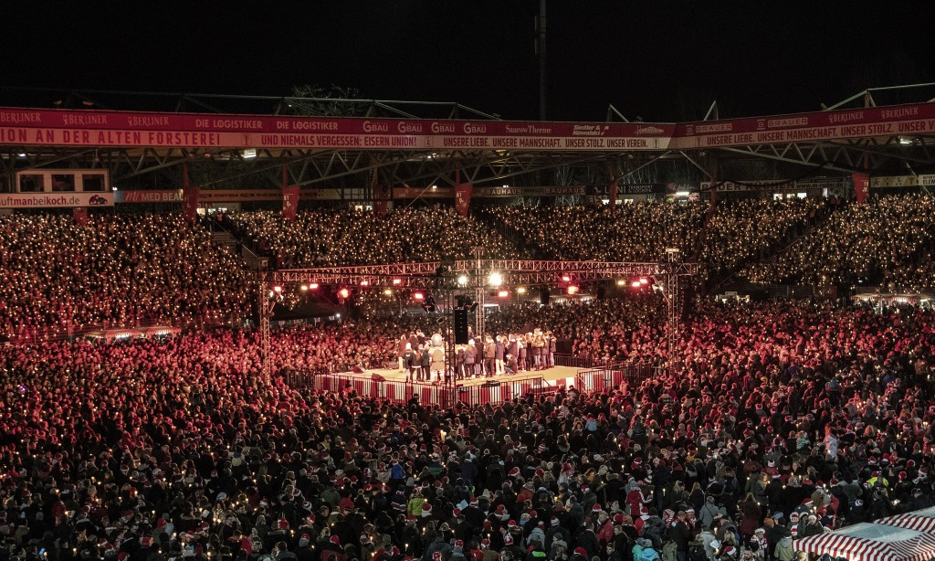 Many thousands of people take part in the Christmas carol singing event at the Alte Forsterei stadium of the German first division soccer team of 1.FC...