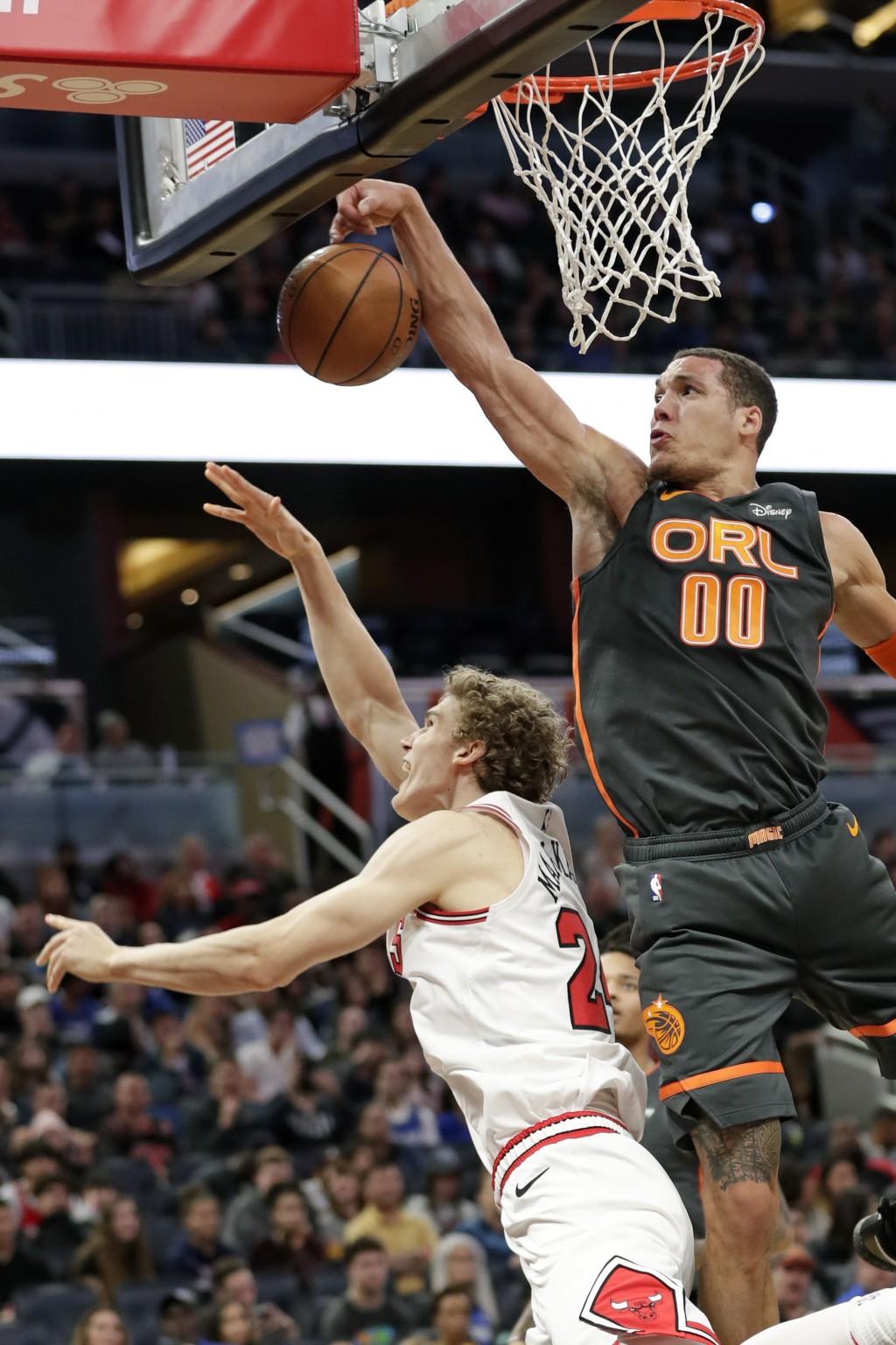 Orlando Magic forward Aaron Gordon (00) blocks a shot attempt by Chicago Bulls forward Lauri Markkanen, left, during the first half of an NBA basketba...