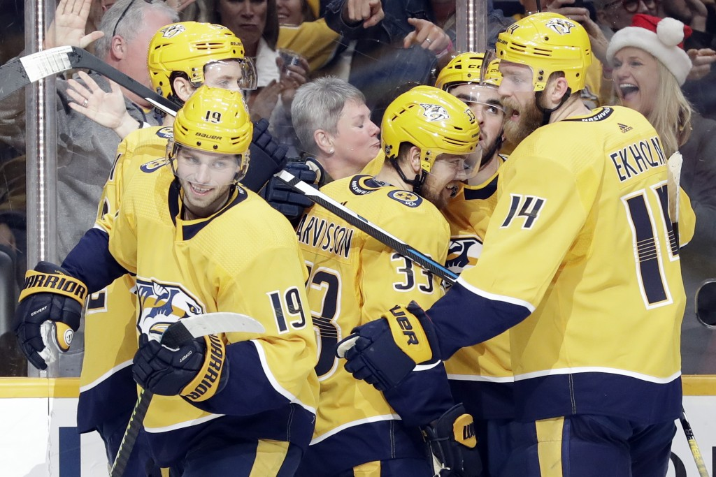 Nashville Predators right wing Viktor Arvidsson (33), of Sweden, celebrates with teammates after scoring a goal against the Arizona Coyotes during the...