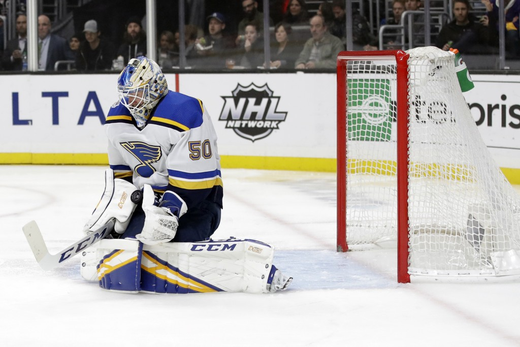 St. Louis Blues goaltender Jordan Binnington stops a shot during the second period of the team's NHL hockey game against the Los Angeles Kings on Mond...