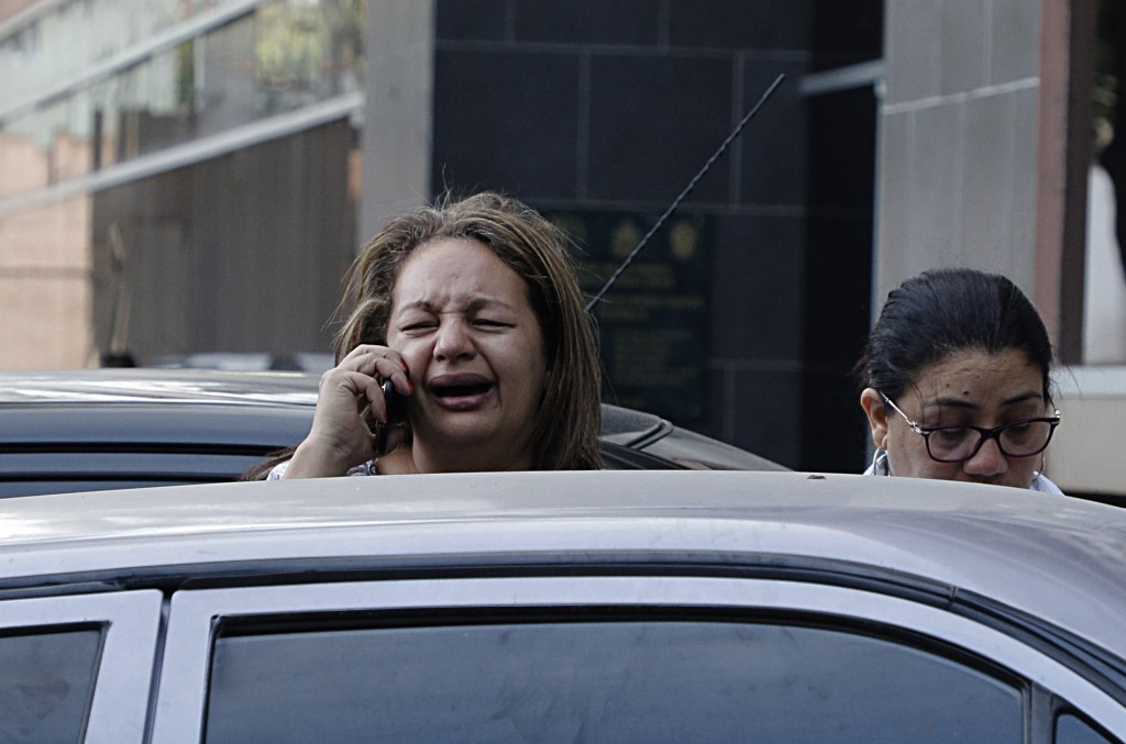 A woman who just learned that her brother Edin Alexis Hernandez is one of the prisoners who died the previous day in a riot inside El Porvenir prison,...