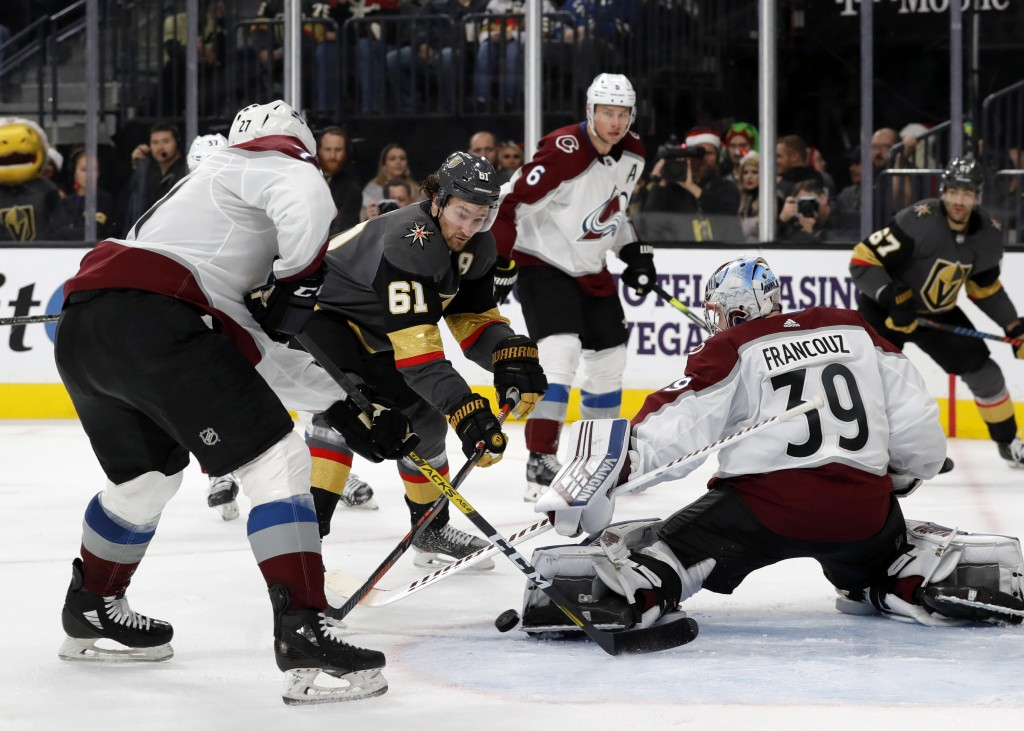 Colorado Avalanche goaltender Pavel Francouz (39) blocks a shot by Vegas Golden Knights right wing Mark Stone (61) during the second period of an NHL ...