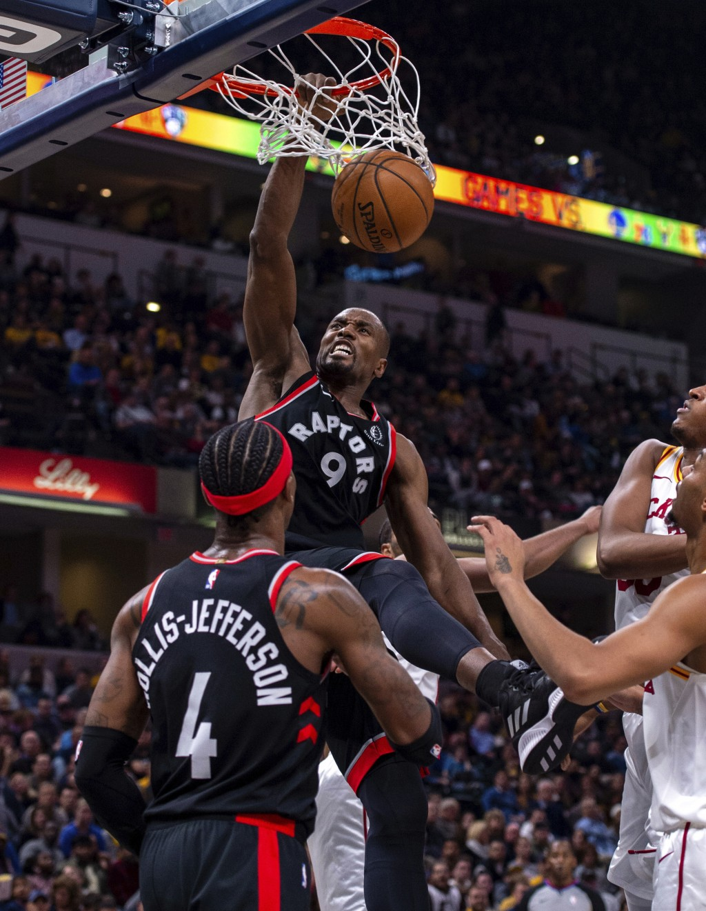 Toronto Raptors forward Serge Ibaka (9) scores with a slam dunk during an NBA basketball game against the Indiana Pacers, Monday, Dec. 23, 2019, in In...