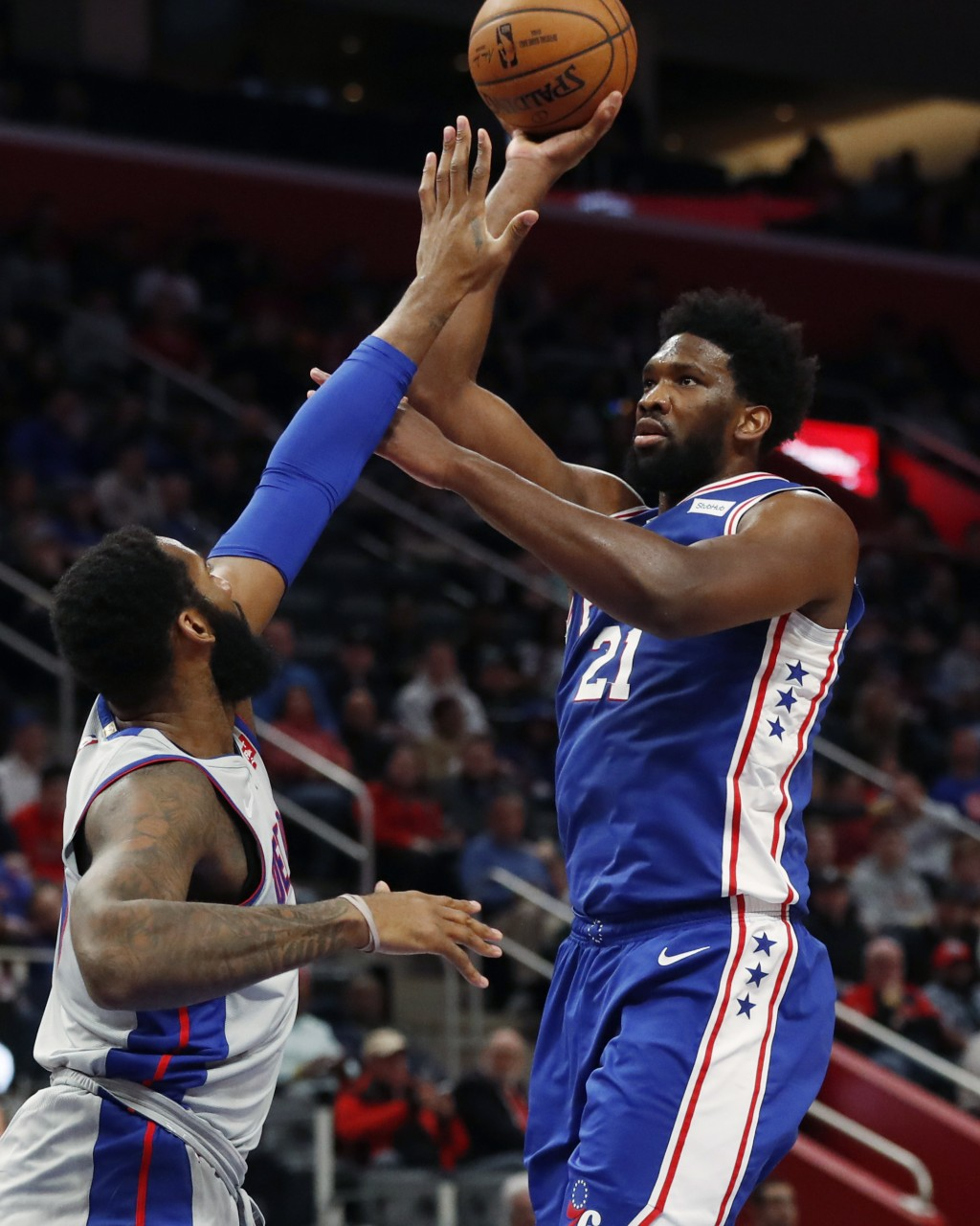 Philadelphia 76ers center Joel Embiid (21) shoots over Detroit Pistons center Andre Drummond during the first half of an NBA basketball game Monday, D...