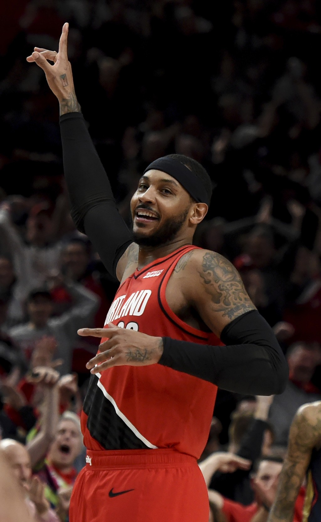 Portland Trail Blazers forward Carmelo Anthony reacts after hitting a shot during the first half of an NBA basketball game against the New Orleans Pel...