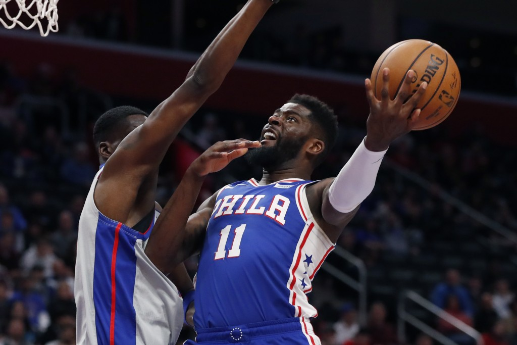 Philadelphia 76ers forward James Ennis III (11), defended by Detroit Pistons guard Tony Snell, attempts a layup during the first half of an NBA basket...
