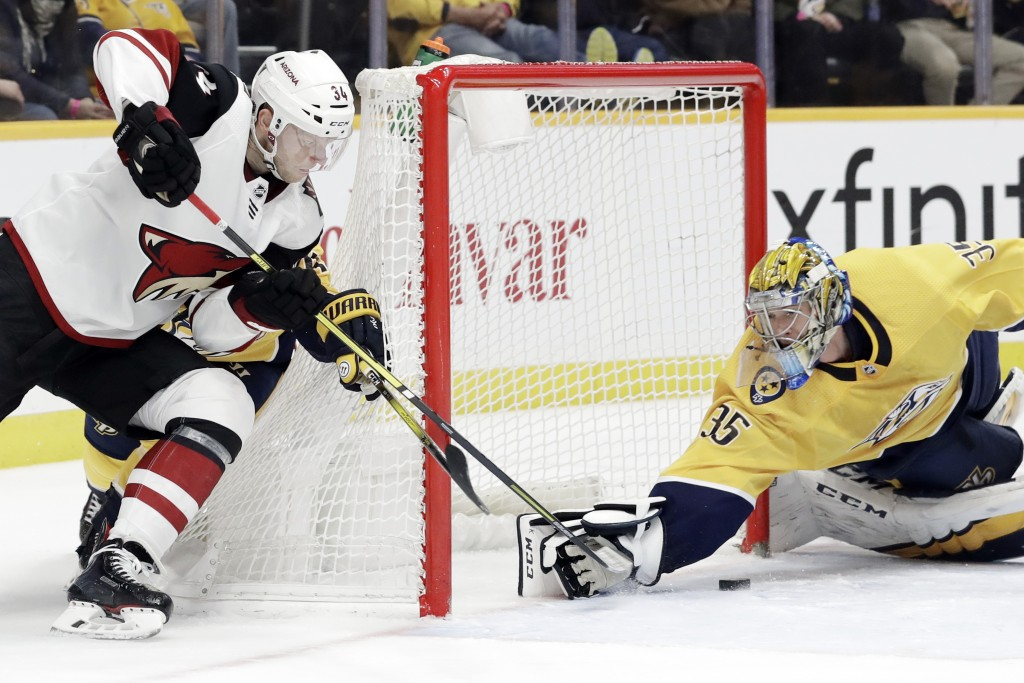 Nashville Predators goaltender Pekka Rinne (35), of Finland, stops a shot by Arizona Coyotes center Carl Soderberg (34), of Sweden, during the third p...