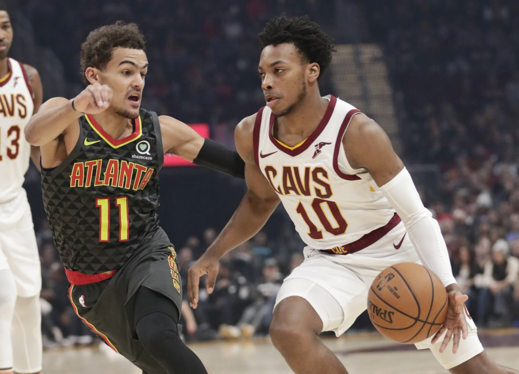 Cleveland Cavaliers' Darius Garland (10) drives past Atlanta Hawks' Trae Young (11) during the first half of an NBA basketball game Monday, Dec. 23, 2...