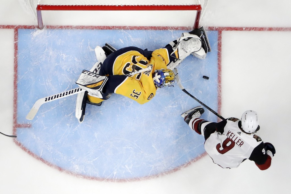 Nashville Predators goaltender Pekka Rinne (35), of Finland, blocks a shot by Arizona Coyotes right wing Clayton Keller (9) during the second period o...